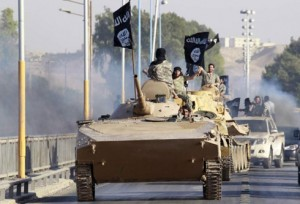 Militant Islamist fighters take part in a military parade along the streets of the northern Raqqa province June 30, 2014. Militant Islamist fighters held a  <p>This content is restricted to site members.  If you are an existing user, please log in.  New users may register below.</p> <div id=