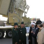 Iran's President Hassan Rouhani (3rd L) and Iranian Defence Minister Hossein Dehghan (2nd L) stand in front of the new air defense missile system Bavar-373, in Tehran, Iran August 21.  /Reuters