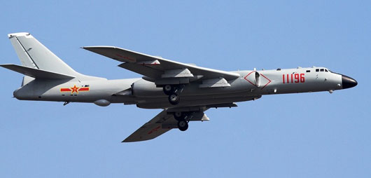 Chinese war planes conduct threatening flights on all sides of Taiwan