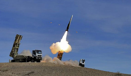 Iran defies West, increases missiles' range and tests