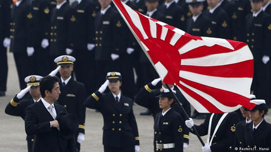 While world looked away, Japan re-emerged as major military power