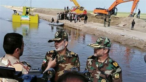 Restive Iranians see Iraqi paramilitary's 'flood relief' as show of power by IRGC