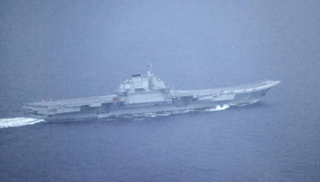 China's navy reacts to intense maritime activity by U.S., Japan, Canada
